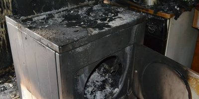 Dryer Charred from fire caused by lint buildup