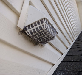 Clogged Dryer Vent with Bird Guard in Maryland