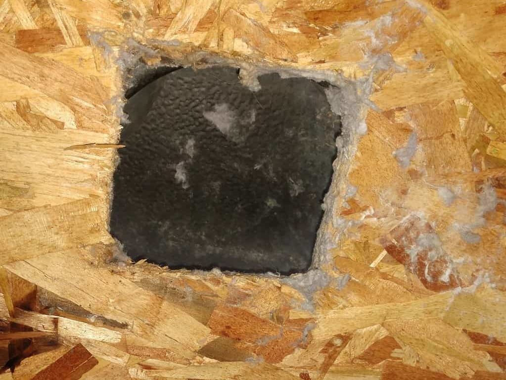 Picture of a dryer vent roof penetration in Walkersville, MD cut too small
