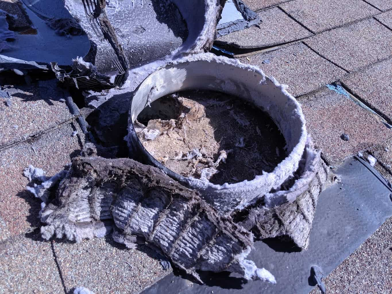 Picture of a dryer vent louver screened roof cover improperly positioned and blocking the vent in Frederick, MD